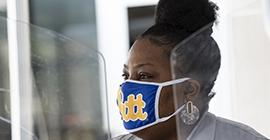 Pitt employee wearing a mask