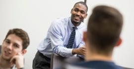 Man talking to students